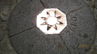 Point Zero brass circle in front of Notre Dame